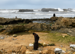 Three pensive men, Essaouira coast