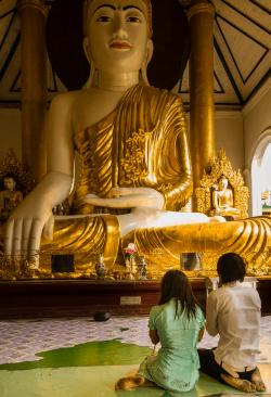 Couple praying, Shwedagon Pagoda temple, Rangoon