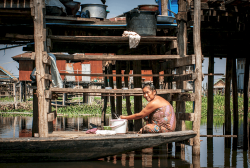 Inle lake woman washing clothes