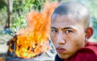 Monk at funeral pyre